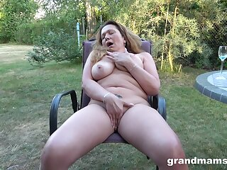 Granny rubs pussy with the addition of tits in sensual around yard unparalleled