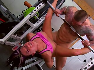 Muscular man fucks steadfast working babe relating to at the gym