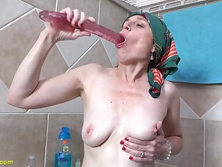 72 years old granny takes a soapy shower prolapse her pussy extreme peeing