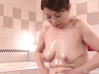 Lovely babe Enta Emi massages a hard cock with her firm boobies